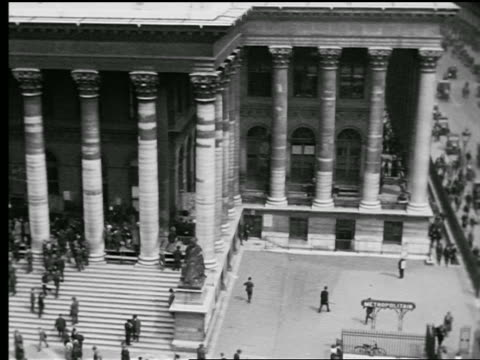 b/w 1927 high angle pan bourse des valeurs with lots of people going up + down stairs in front / paris, france - paris stock exchange stock videos & royalty-free footage