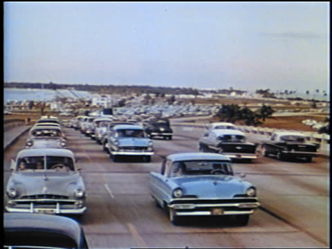 1958 high angle bumper to bumper traffic on highway / may be florida / newsreel - 1958 stock videos & royalty-free footage