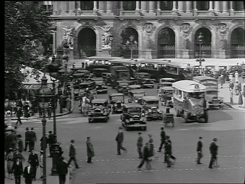 b/w 1927 high angle busy intersection with traffic + people in place de l'opera / paris, france - place de l'opera stock videos and b-roll footage