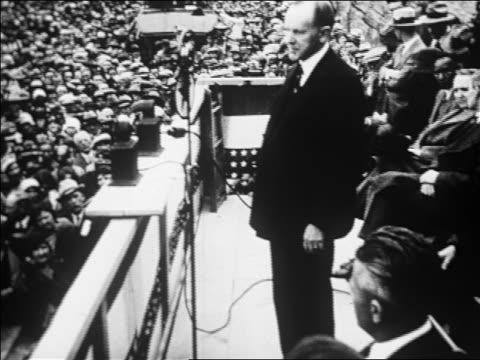 vídeos y material grabado en eventos de stock de b/w 1926 high angle calvin coolidge speaking at dam dedication ceremony / san carlos az / newsreel - 1926