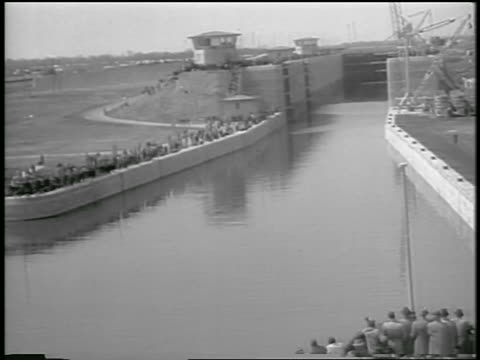 b/w 1959 high angle canal lock system of st lawrence seaway / people on edge / canada / newsreel - 1959 stock videos & royalty-free footage