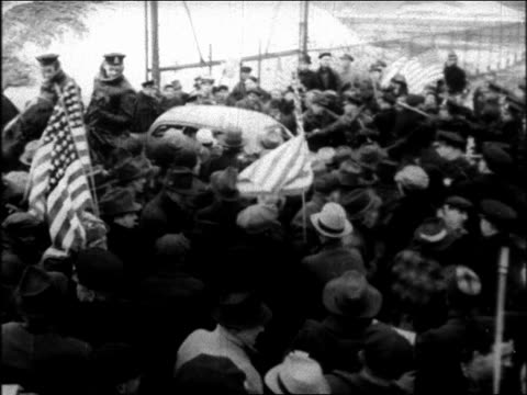 B/W 1937 high angle PAN car driving thru crowd of mounted police + strikers with American flags