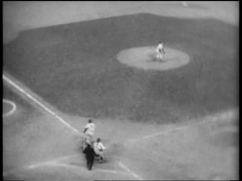 vídeos de stock e filmes b-roll de b/w 1953 high angle pan carl furillo hitting baseball into stands running around bases / world series - camisola de basebol