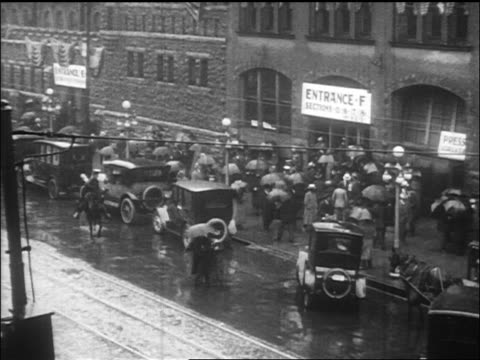 b/w 1912 high angle pan cars people with umbrellas outside republican convention in rain / chicago / doc - republican national convention stock videos & royalty-free footage