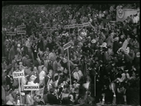b/w 1952 high angle cheering crowd at republican national convention in chicago / newsreel - anno 1952 video stock e b–roll