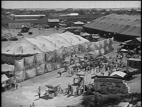 b/w 1946 high angle pan circus tents + crowd of people outdoors - yorkville illinois stock videos & royalty-free footage