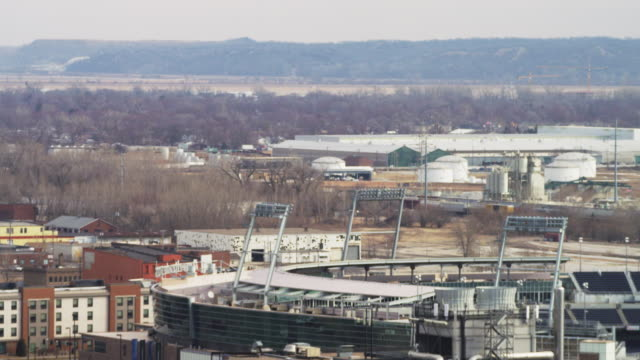 high angle cityscape looking southeast with td ameritrade baseball park in foreground, an industrial area and the loess hills in the distance. - omaha stock videos & royalty-free footage