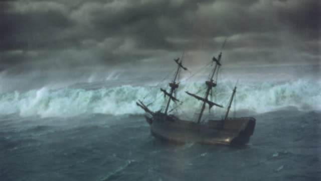 high angle clipper ship capsizing on rough seas during storm / Plymouth Adventure (1952)