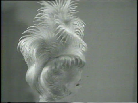 b/w 1960 high angle close up blonde model with extraordinary hairstyle turning towards camera / newsreel - haute couture stock videos and b-roll footage