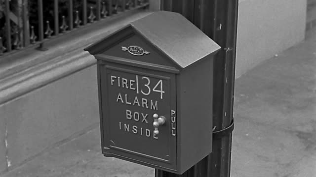 high angle close up fire alarm box on pole / gloved hand opening box / breaking glass to set off alarm - fire alarm stock videos & royalty-free footage