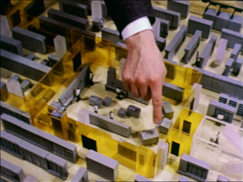 vídeos de stock, filmes e b-roll de 1957 high angle close up hand of man pointing to control room in model of building-sized air force sage computer - 1957