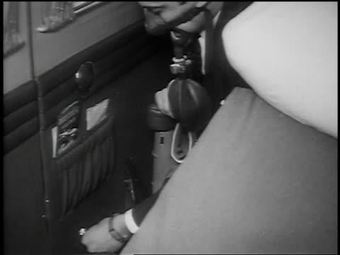 B/W 1939 high angle close up man using oxygen mask on airplane