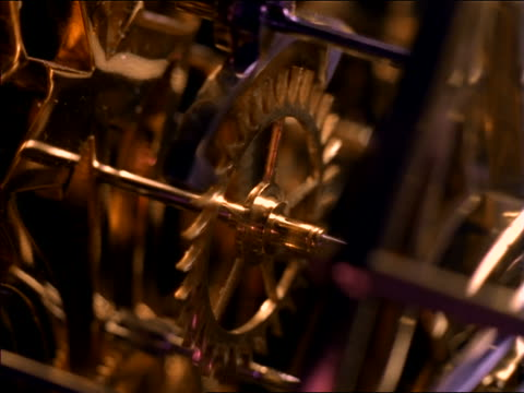 high angle close up of gears moving in clock - clockworks stock videos & royalty-free footage