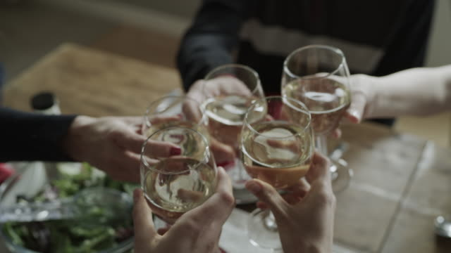 high angle close up of hands of people toasting with wine at table / orem, utah, united states - five people stock-videos und b-roll-filmmaterial