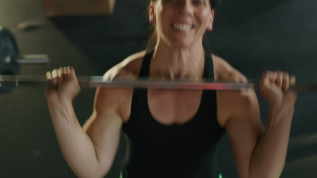 high angle close up of woman lifting barbell in gymnasium / lehi, utah, united states - lehi stock videos & royalty-free footage