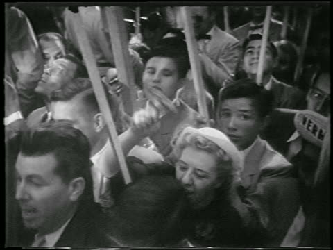 b/w 1952 high angle close up people in crowd holding signs at democratic national convention / chicago / newsreel - anno 1952 video stock e b–roll