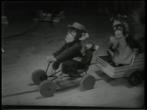 b/w 1951 high angle close up toy monkeys in wagons on floor of window display - 1951 stock videos & royalty-free footage
