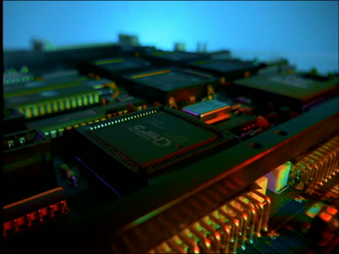 high angle close up tracking shot over circuit board / computer parts