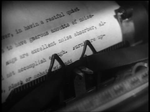 B/W 1937 high angle close up typewriter + document being typed
