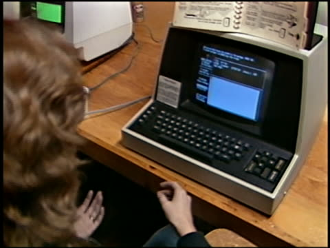 1984 high angle close up woman working with early email program on computer screen / Marin, California