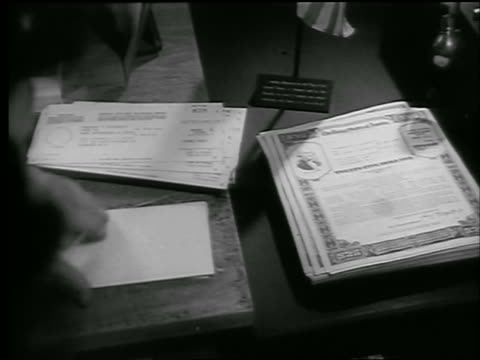 b/w 1944 high angle close up woman's hands sorting army war bonds in office / world war ii / newsreel - 1944 stock videos and b-roll footage