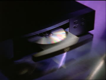 high angle close up zoom out dvd player opening - dvd stock videos & royalty-free footage