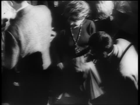 B/W 1961 high angle PAN couples dancing the Twist on dance floor / newsreel