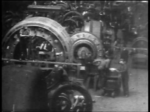 B/W 1904 high angle crane shot workers + large machinery in Westinghouse factory / Pennsylvania / newsreel