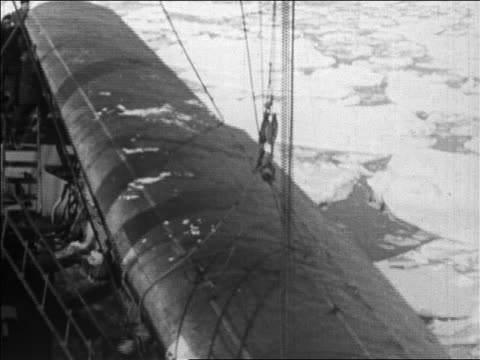 high angle crane unloading airplane wing for admiral byrd's flight over the north pole / newsreel - 1926 stock videos & royalty-free footage
