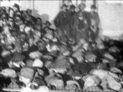 high angle crowd at le bourget airfield at night waiting to greet lindbergh / paris / newsreel - anno 1927 video stock e b–roll