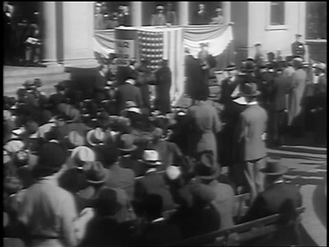 b/w 1933 high angle crowd at podium to sign giant book for disarmament conference in geneva / union square - 1933 stock videos and b-roll footage