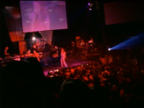high angle crowd cheering + perfomers on stage in rock concert in club - pop musician stock videos and b-roll footage