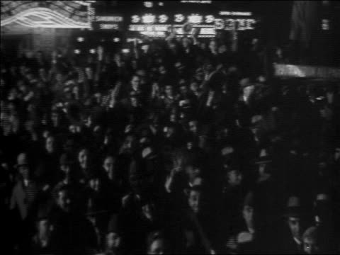 b/w 1932 high angle crowd cheering waving outdoors at night / election night - 1932 stock videos & royalty-free footage