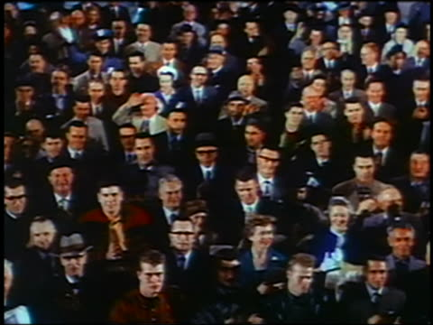 1961 high angle crowd clapping at GM Motorama show / industrial