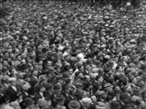 vidéos et rushes de b/w 1928 high angle pan crowd gathered at rally for al smith during presidential campaign / documentary - 1928
