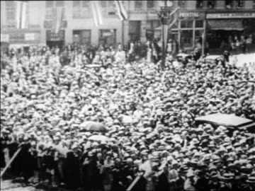stockvideo's en b-roll-footage met high angle crowd gathered on street during herbert hoover campaign / newsreel - 1928