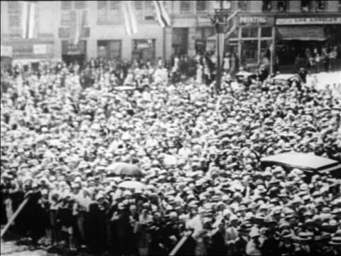 b/w 1928 high angle pan crowd gathered on street during herbert hoover campaign / newsreel - 1928 stock videos & royalty-free footage