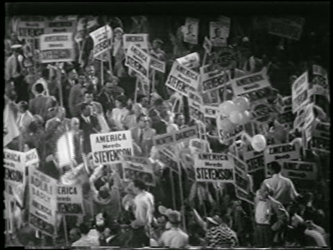 """high angle crowd holding """"adlai stevenson"""" signs at democratic national convention / newsreel - 1952 stock videos & royalty-free footage"""