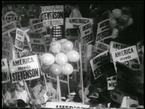 b/w 1952 high angle crowd holding adlai stevenson signs at democratic national convention / newsreel - anno 1952 video stock e b–roll