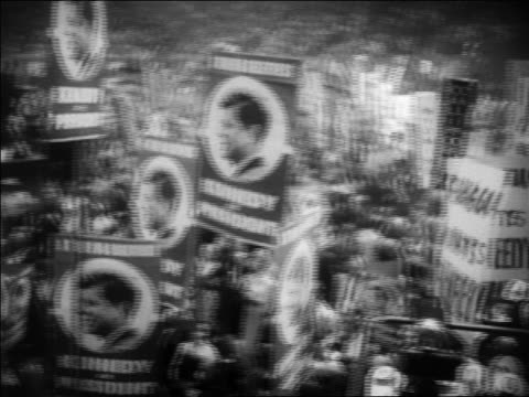 B/W 1960 high angle PAN crowd holding John Kennedy signs at Democratic National Convention / Los Angeles