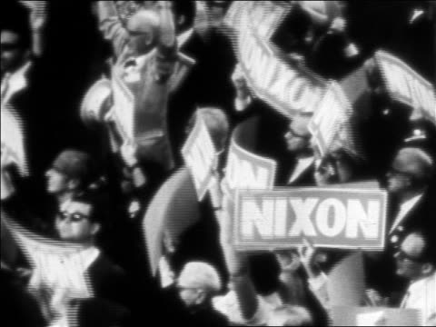 b/w 1968 high angle crowd holding nixon signs at republican national convention / miami - 1968 stock videos & royalty-free footage