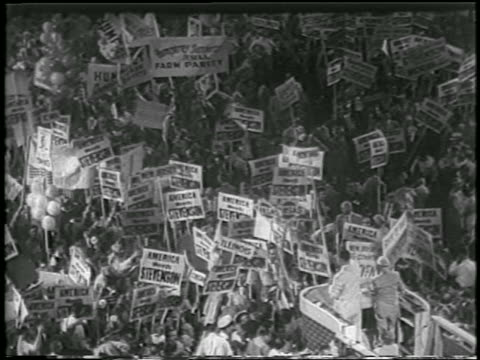 b/w 1952 high angle crowd holding stevenson signs at democratic national convention / chicago / newsreel - anno 1952 video stock e b–roll