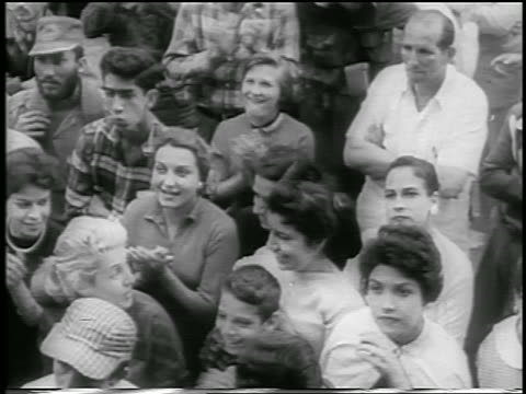 b/w 1959 high angle crowd looking up smiling clapping / postrevolution havana / newsreel - 1959 stock-videos und b-roll-filmmaterial