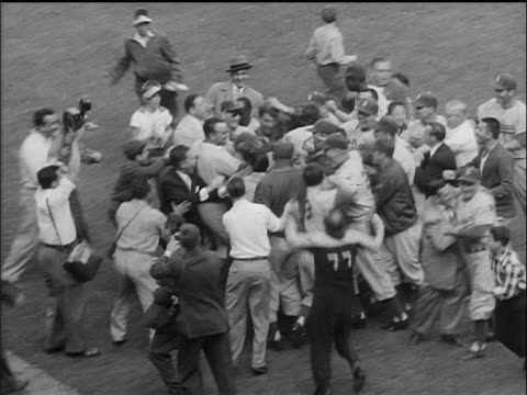 stockvideo's en b-roll-footage met high angle crowd of brooklyn dodgers celebrating + moving across field at end of world series - 1955