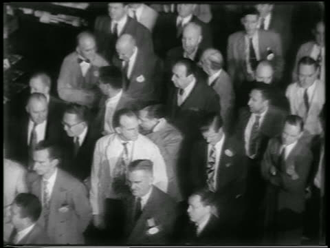 vídeos y material grabado en eventos de stock de b/w 1951 high angle crowd of businessmen in ny stock exchange during civil defense drill / nyc / newsreel - 1951