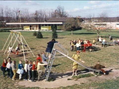1962 high angle crowd of children on school playground playing games + on slide / industrial - schoolgirl stock videos and b-roll footage