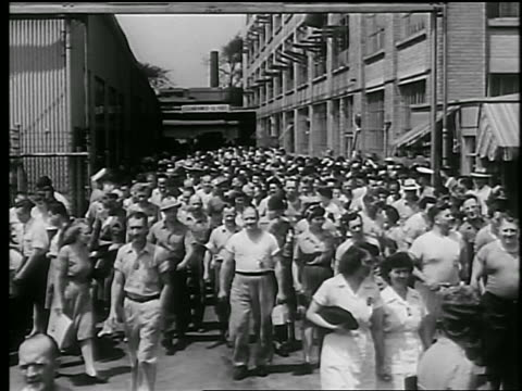 B/W 1944 high angle crowd of defense workers (men + women) exiting factory complex