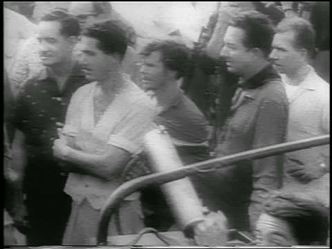 b/w 1959 high angle pan crowd of guerrilla soldiers / cuba / newsreel - 1959 stock-videos und b-roll-filmmaterial
