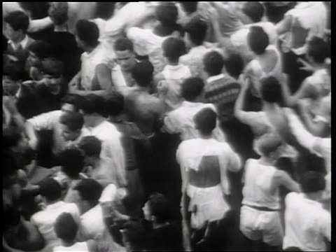 B/W 1931 high angle crowd of male Columbia University students fighting on street outdoors / NYC / newsreel