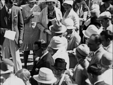 b/w 1929 high angle crowd of passengers clapping hands to music on deck of s.s. honolulu ship / newsreel - 1920 1929 stock videos & royalty-free footage
